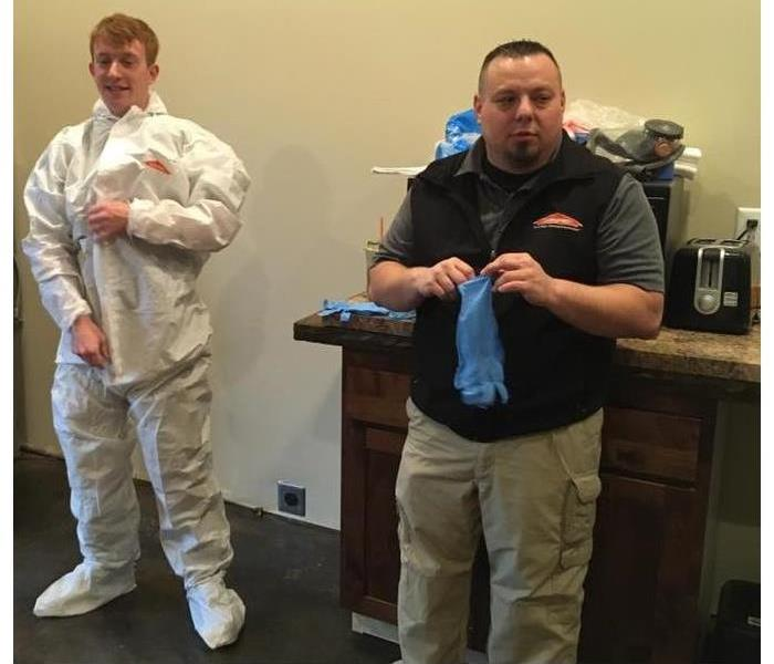 Axel and Daniel from SERVPRO of Benton/Linn county are demostration how to use Personal Protective Equipment.