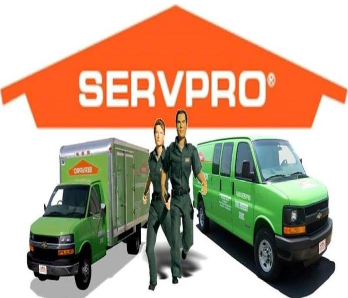 SERVPRO truck and van with man and female responders